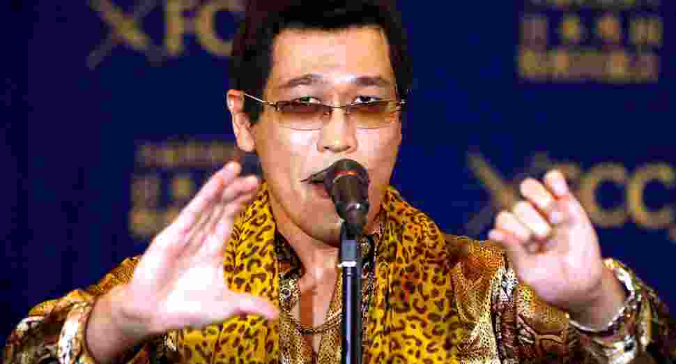 "Japanese singer and song writer Pikotaro, also known by his comedian name Kosaka Daimaou or his real name Kazuhito Kosaka, who is a current Youtube star with his song ""PPAP"" (short for Pen-Pineapple-Apple-Pen), performs before media at a news conference at at the Foreign Correspondents' Club of Japan in Tokyo, Japan October 28, 2016. REUTERS/Issei Kato"